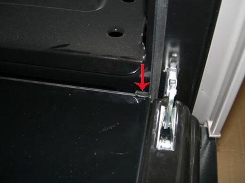 Демонтаж дверцы духовки