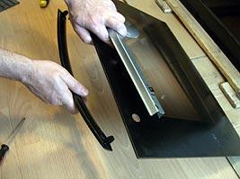 Снятие ручки дверцы духовки