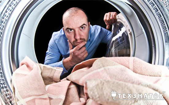 почему пахнет из стиральной машины болотом